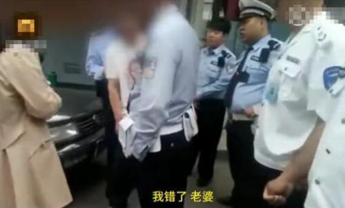 莫名喜感!醉酒男躺地不停骂警察 见到老婆后秒怂